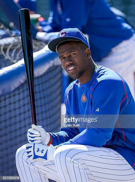 Jorge Soler of the Chicago Cubs waits his turn for batting practice before the game against the Colorado Rockies at Wrigley Field on April 16 2016 in...
