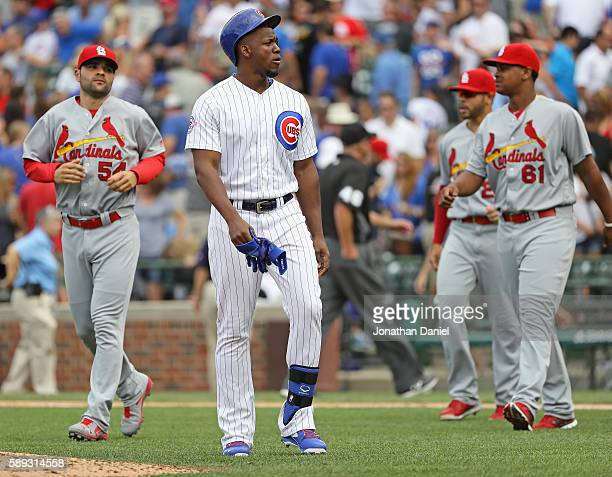 Jorge Soler of the Chicago Cubs walks back to the dugout after grounding out to end the game against the St Louis Cardinals at Wrigley Field on...