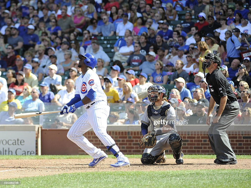 Jorge Soler #68 of the Chicago Cubs watches his double against the Milwaukee Brewers during the sixth inning on September 1, 2014 at Wrigley Field in Chicago, Illinois.