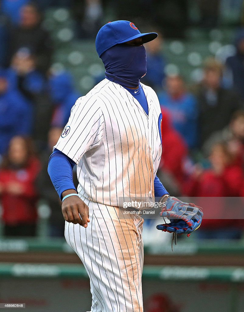Jorge Soler #68 of the Chicago Cubs, with his face covered against the cold, runs off of the field after a win against the St. Louis Cardinals at Wrigley Field on April 8, 2015 in Chicago, Illinois. The Cubs defeated the Cardinals 2-0.