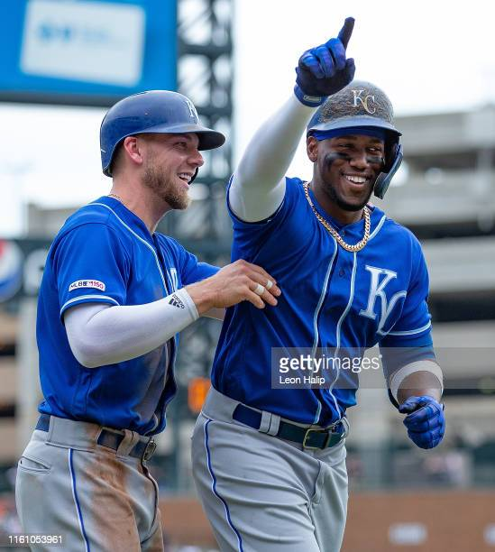 Jorge Soler of the Kansas City Royals celebrates a solo home run in the third inning with teammate Hunter Dozier during the game against the Detroit...