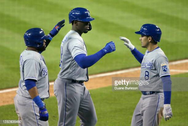 Jorge Soler of the Kansas City Royals celebrates with Carlos Santana and Nicky Lopez after hitting a three-run home run against the Detroit Tigers...