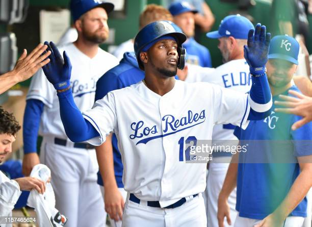 Jorge Soler of the Kansas City Royals celebrates with teammates after scoring on a Cheslor Cuthbert double in the first inning against the Minnesota...