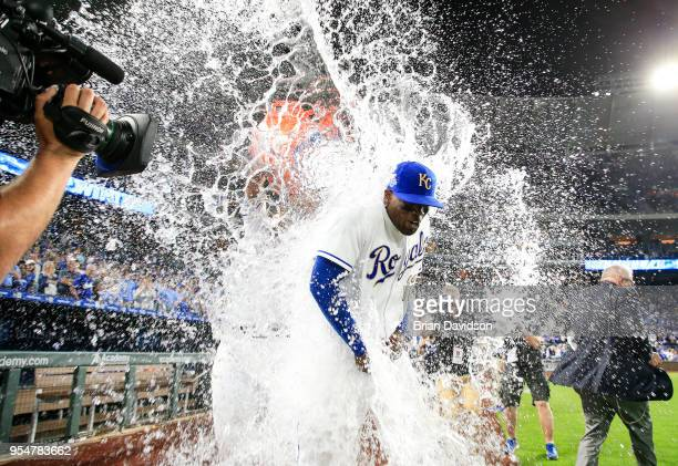 Jorge Soler of the Kansas City Royals gets water dumped on him by teammate Salvador Perez after defeating the Detroit Tigers at Kauffman Stadium on...