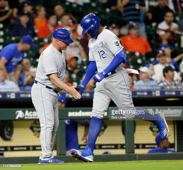 Jorge Soler of the Kansas City Royals is congratulated by third base coach Mike Jirschele after hitting a home run in the second inning against the...
