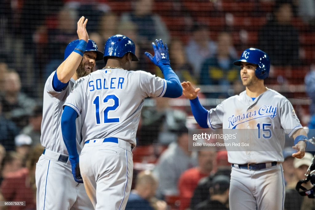 Jorge Soler #12 of the Kansas City Royals reacts with Whit Merrifield #15 and Alex Gordon #4 after hitting a go ahead three run home run during the thirteenth inning of a game against the Boston Red Sox on May 1, 2018 at Fenway Park in Boston, Massachusetts.