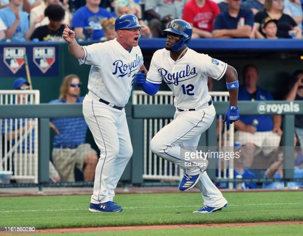 Jorge Soler of the Kansas City Royals runs past third base coach Mike Jirschele as he heads home to score on a Nicky Lopez single in in the fifth...