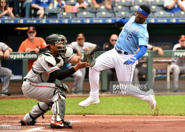 Jorge Soler of the Kansas City Royals slides into home to score against catcher Pedro Severino of the Baltimore Orioles on a Hunter Dozier double in...