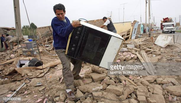Jorge Soto collects his belongings from his destroyed house in Tambo de Mora port in Chincha more than 250 km south of Lima 17 August 2007 Powerful...