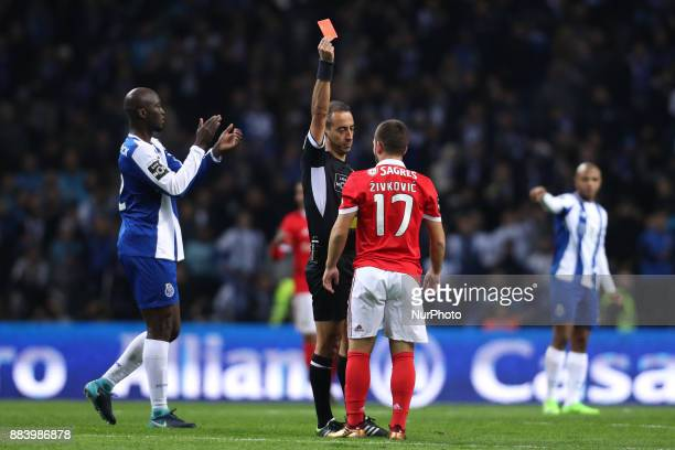 Jorge Sousa referee shows the red card to Benfica's Serbian forward Andrija Zivkovic during the Premier League 2016/17 match between FC Porto and SL...