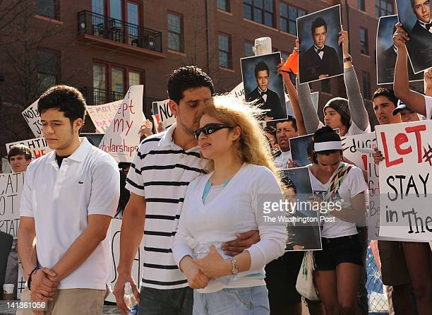 Jorge Steven Acuna left is stands with his parents Jorge Acuna Sr and Blanca during a rally organized by Casa de Maryland at Rockville Town Center on...