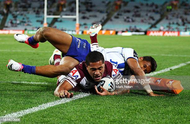 Jorge Taufua of Manly scores as Ben Barba of the Bulldogs tackles during the First NRL Qualifying Final match between the Canterbury Bulldogs and the...
