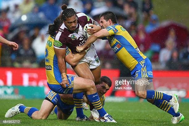 Jorge Taufua of the Eagles is tackled during the round 24 NRL match between the Manly Warringah Sea Eagles and the Parramatta Eels at Brookvale Oval...