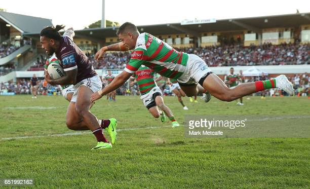 Jorge Taufua of the Sea Eagles evades the tackle of Braidon Burns of the Rabbitohs during the round two NRL match between the Manly Sea Eagles and...