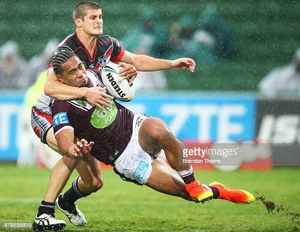 Jorge Taufua of the Sea Eagles is tackled by Blake Ayshford of the Warriors during the round 19 NRL match between the Manly Sea Eagles and the New...