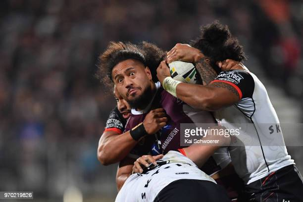 Jorge Taufua of the Sea Eagles is tackled during the round 14 NRL match between the Manly Sea Eagles and the New Zealand Warriors at AMI Stadium on...