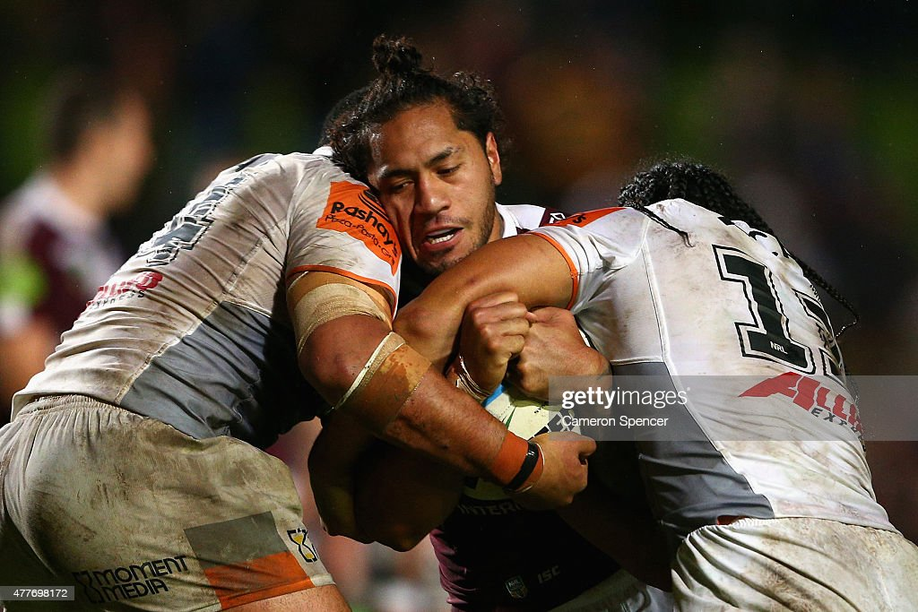 Jorge Taufua of the Sea Eagles is tackled during the round 15 NRL match between the Manly Sea Eagles and the Wests Tigers at Brookvale Oval on June 19, 2015 in Sydney, Australia.
