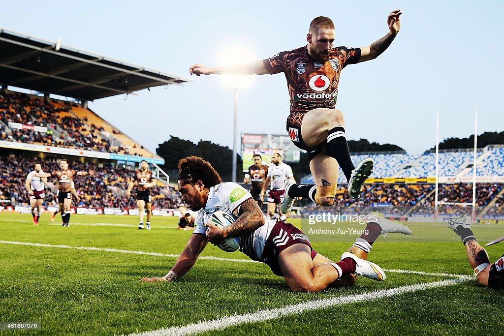 Jorge Taufua of the Sea Eagles runs a disallowed try against Sam Tomkins of the Warriors during the round 20 NRL match between the New Zealand Warriors and the Manly Sea Eagles at Mt Smart Stadium on July 25, 2015 in Auckland, New Zealand.