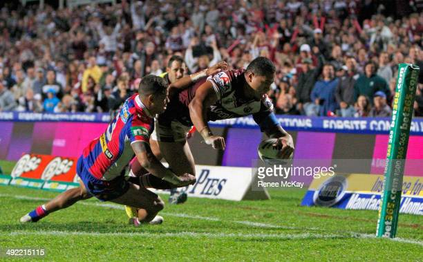 Jorge Taufua of the Sea Eagles scores a try during the round 10 NRL match between the Manly-Warringah Sea Eagles and the Newcastle Knights at...