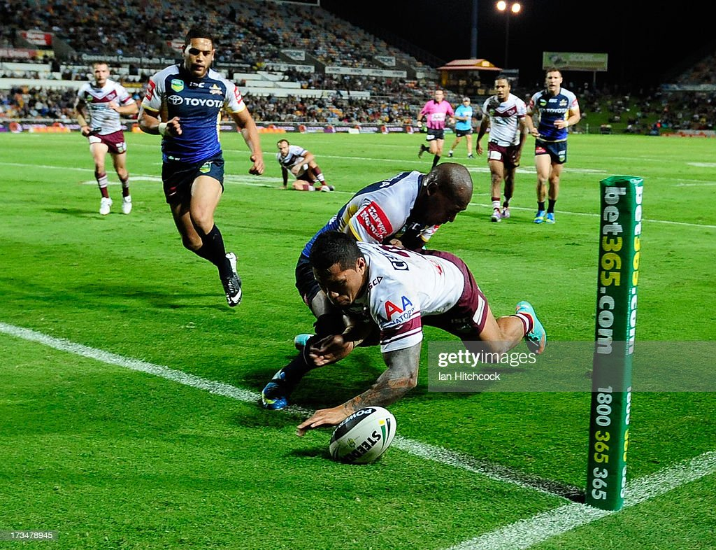 Jorge Taufua of the Sea Eagles scores a try during the round 18 NRL match between the North Queensland Cowboys and the Manly Sea Eagles at 1300SMILES Stadium on July 15, 2013 in Townsville, Australia.