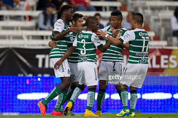 Jorge Tavares of Santos and his teammates celebrate their first goal during the game between Leones Negros and Santos Laguna as part of 15th round...