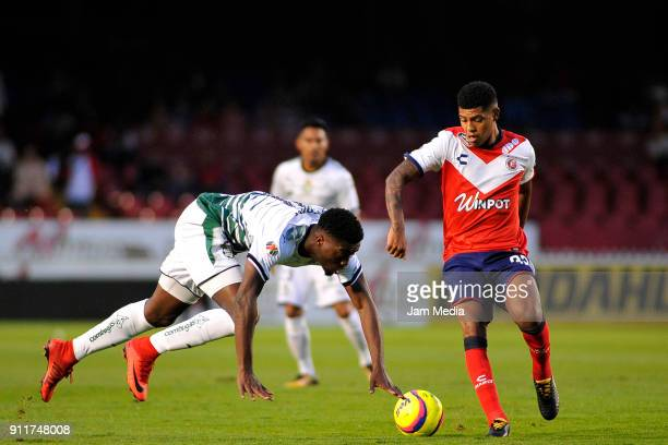 Jorge Tavares of Santos and Wilder Cartagena of Veracruz compete for the ball during the 4th round match between Veracruz and Santos Laguna as part...