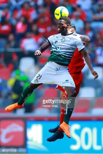 Jorge Tavares of Santos Laguna heads for the ball with Maximiliano Perg of Toluca during the 8th round match between Toluca and Santos Laguna as part...