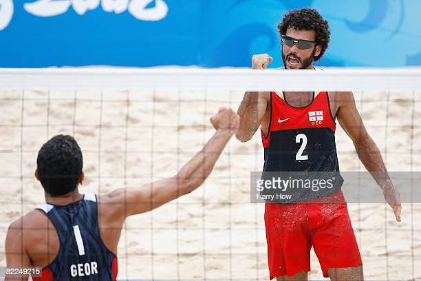 Jorge Terceiro and Renato Gomes of Georgia react against Ricardo Santos of Brazil during the beach volleyball event at the Chaoyang Park Beach...