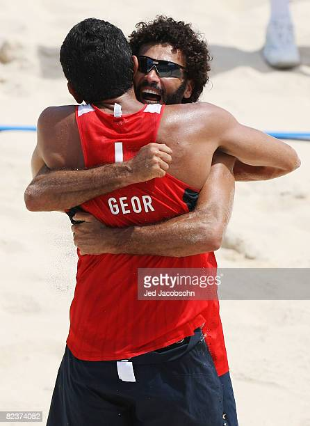 Jorge Terceiro of Georgia and partner Renato Gomes react as they defeat Clemens Doppler and Peter Gartmayer of Austria in the beach volleyball event...
