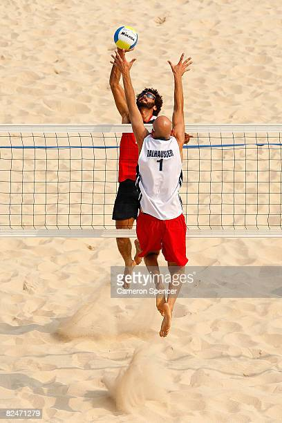 Jorge Terceiro of Georgia goes for a spike over Phil Dalhausser of the United States during the men's semifinal beach volleyball match at the...