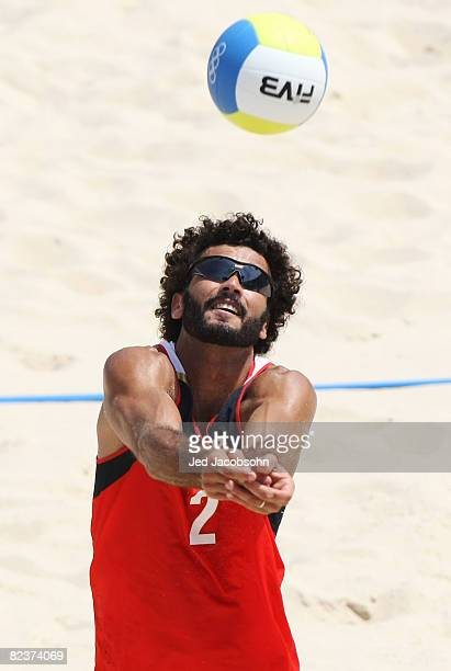 Jorge Terceiro of Georgia hits the ball alongside partner Renato Gomes while taking on Clemens Doppler and Peter Gartmayer of Austria in the beach...