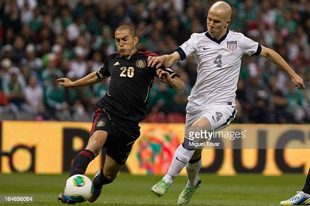 Jorge Torres of Mexico fights for the ball with Michael Bradley of the United States during a match between Mexico and US as part of FIFA 2014 World...