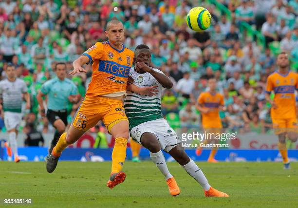 Jorge Torres of Tigres and Edwuin Cetre of Santos during the quarter finals second leg match between Santos Laguna and Tigres UANL as part of the...
