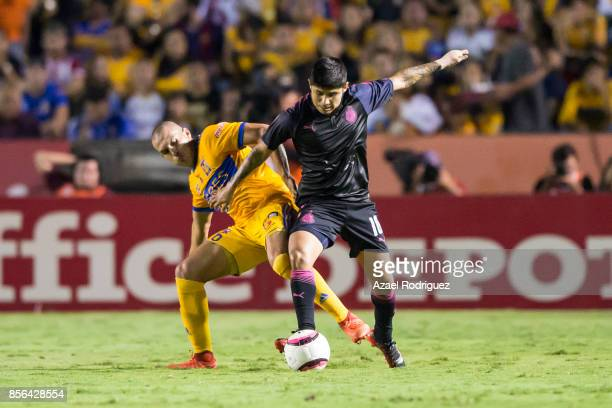 Jorge Torres of Tigres fights for the ball with Javier Lopez of Chivas during the 12th round match between Tigres UANL and Chivas as part of the...