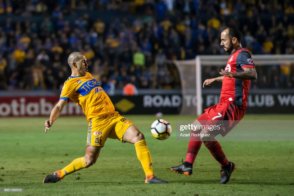 Jorge Torres of Tigres fights for the ball with Victor Vazquez of Toronto during the quarterfinals second leg match between Tigres UANL and Toronto FC as part of the CONCACAF Champions League 2018 at Universitario Stadium on March 13, 2018 in Monterrey, Mexico.