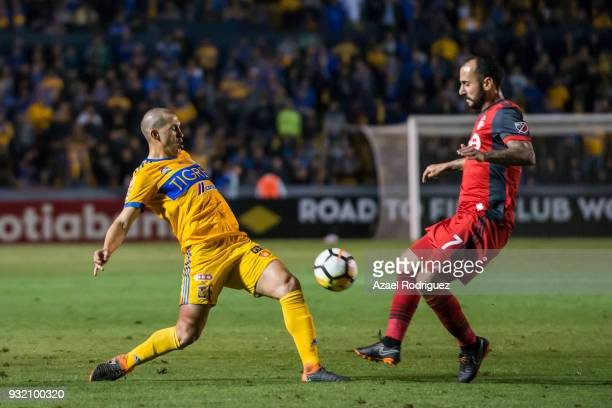 Jorge Torres of Tigres fights for the ball with Victor Vazquez of Toronto during the quarterfinals second leg match between Tigres UANL and Toronto...