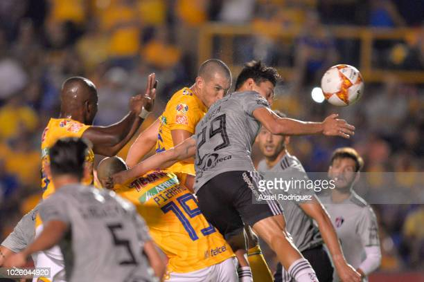 Jorge Torres of Tigres heads the ball and scores his team's first goal during the 6th round match between Tigres UANL and Veracruz as part of the...