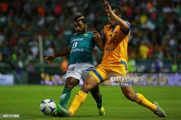 Jorge Torres of Tigres struggles for the ball with Jonathan Gonzales of Leon during a 4th round match between Leon and Tigres UANL as part of the...