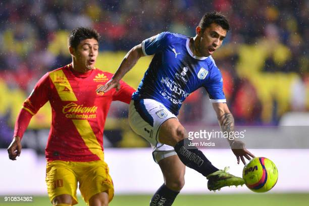 Jorge Valadez of Morelia and Edson Puch of Queretaro fight for the ball during the 4th round match between Monarcas and Queretaro as part of the...