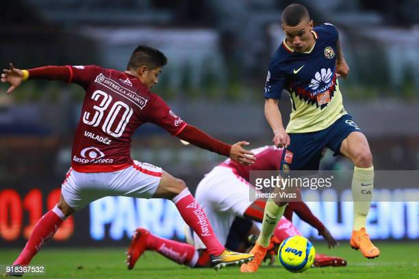 Jorge Valadez of Morelia struggles for the ball with Matheus Uribe of America during the 7th round match between America and Monarcas as part of the...