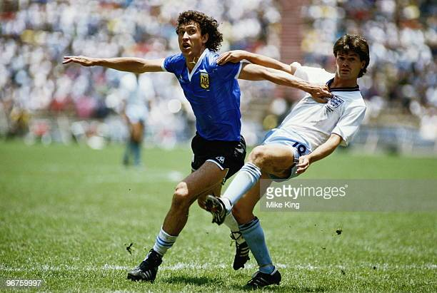 Jorge Valdano of Argentina and Steve Hodge of England in action during the 1986 FIFA World Cup Quarter Final on 22 June 1986 at the Azteca Stadium in...