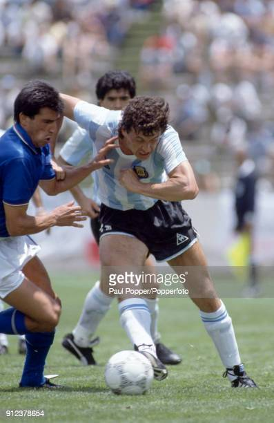Jorge Valdano of Argentina is challenged by Salvatore Bagni of Italy during the FIFA World Cup match between Italy and Argentina at the Estadio...