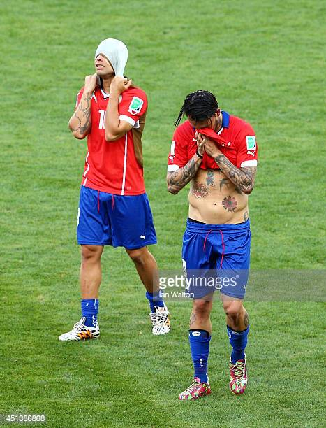 Jorge Valdivia and Mauricio Pinilla of Chile look dejected after being defeated by Brazil in the penatly shootout during the 2014 FIFA World Cup...