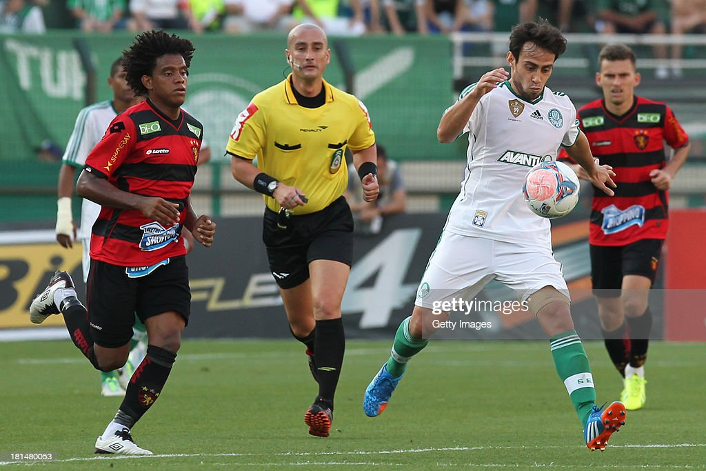 Jorge Valdivia, from Palmeiras, followed by Rithely, from Sport, fight for the ball during the match between Palmeiras and Sport for the Brazilian Series B 2013 at Pacaembu stadium on September 21, 2013 in Sao Paulo, Brazil.