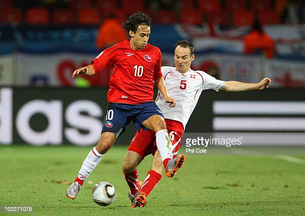 Jorge Valdivia of Chile and Steve von Bergen of Switzerland battle for the ball during the 2010 FIFA World Cup South Africa Group H match between...