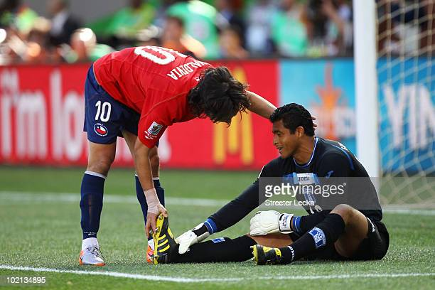 Jorge Valdivia of Chile assists goalkeeper Noel Valladares of Honduras during the 2010 FIFA World Cup South Africa Group H match between Honduras and...
