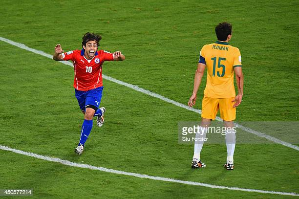 Jorge Valdivia of Chile celebrates after scoring the team's second goal as Mile Jedinak of Australia looks on during the 2014 FIFA World Cup Brazil...
