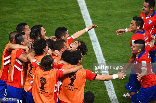 Jorge Valdivia of Chile celebrates scoring the team's second goal on the sidelines during the 2014 FIFA World Cup Brazil Group B match between Chile...