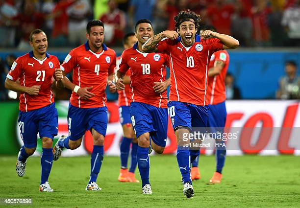 Jorge Valdivia of Chile celebrates with team-mates after scoring a goal during the 2014 FIFA World Cup Brazil Group B match between Chile and...