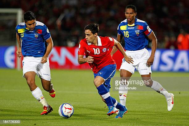 Jorge Valdivia of Chile fights for the ball during a match between Chile and Ecuador as part of the 18th round of the South American Qualifiers at...